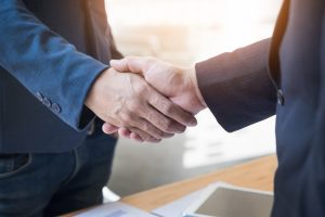 two-confident-business-man-shaking-hands-during-meeting-office-success-dealing-greeting-partner-concept